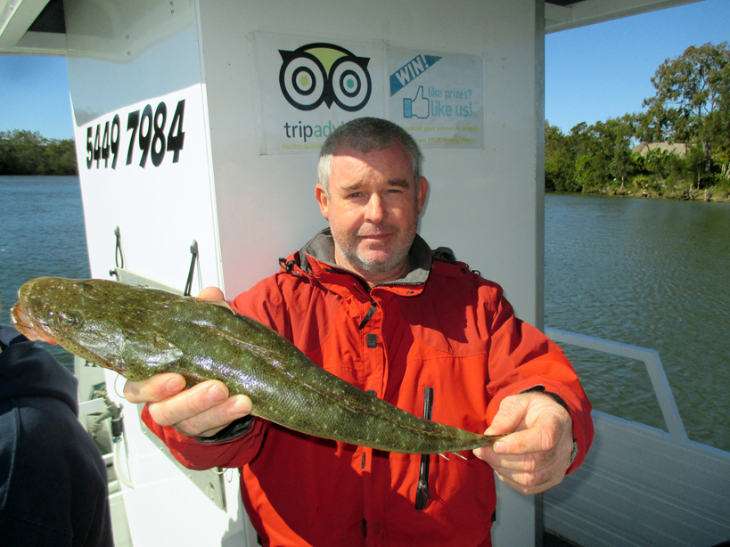 Keith from Brisbane caught a ripper 60cm flathead aboard the Noosa Fishing and Crab Adventures.